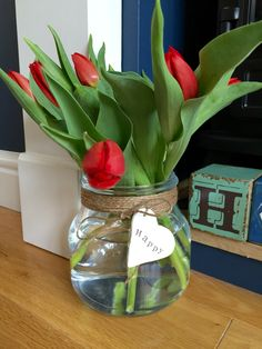 IKEA vase makeover. Used garden twine around the rim. Added a clay heart and stamped with vintage lettering.
