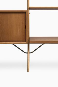 Kurt Østervig bookcase in teak, oak and brass at Studio Schalling #midcenturymodern #design #retro