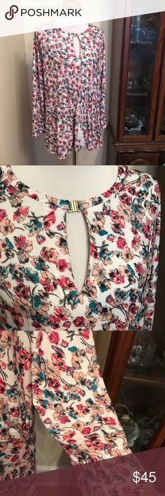 {LoLo Lucy} pullover top NWT. Gorgeous LoLo Lucy top. Floral pattern, drawstring waist, keyhole neck with a hook closure, and tiny cuffed bell sleeves. LoLo Lucy Tops Tees - Long Sleeve