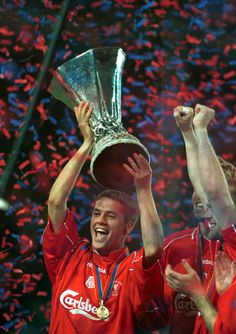 Michael Owen lifts the trophy as Liverpool win the UEFA Cup Final between Liverpool and Deportivo Alaves at the Westfallenstadion Dortmund Germany...