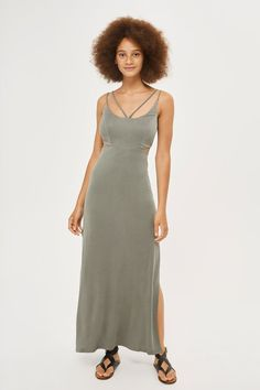 This elegant khaki slip dress comes with cut out side detailing for a contemporary twist. Featuring skinny straps and a strappy design on the chest, it's complete with a side split.