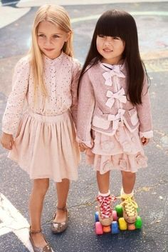 Children's fashion at it's best! Love these little pink outfits.