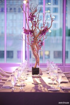 Purple dendrobium orchid blossoms on tree branches placed in glass vase filled with exposed green moss. Crystal garland strung along branches. Floral Wedding, Fall Wedding, Wedding Reception, Wedding Flowers, Dream Wedding, Wedding Ideas, Orchid Centerpieces, Wedding Centerpieces, Wedding Decorations