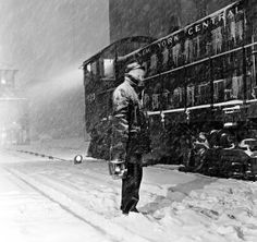 Troy Union Railroad crossing guard John Moriarity and New York Central switch engine during snowstorm, Troy, New York, March 1955 Photographer Jim Shaughnessy