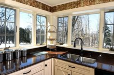 Windows over Silestone countertops and sink in kitchen.