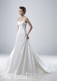 Gown features low back, detachable rose detail, and applique train.