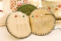 Tutorial: How to Make a Needlebook  {jrs: I love the perpetual calendar on this link that uses juice can lids.}
