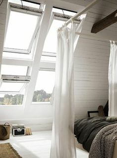 Whitewashed Wood Walls, Large Grid Windows, Vaulted Ceilings, Bed Curtains, Exposed Beams // airy