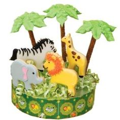 Stage a safari atop a craft circle embellished with Jungle Pals Party Bags and jungle-critter cookies. Use the horse, giraffe, elephant and lion cutters from our 50-pc. Animal Pals Cutter Set, color flow and piped icing to fashion flavorful figures.#Repin By:Pinterest++ for iPad#
