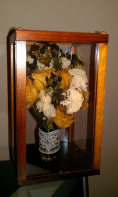 These hexagon cases can accommodate a large bouquet preserved for a ...