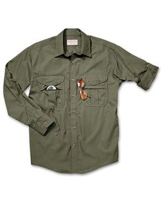Filson's feather cloth shirt made with light cotton that will dry quickly and will hold up to a beating. I wear these in every hot weather country I visit and have never been let down!