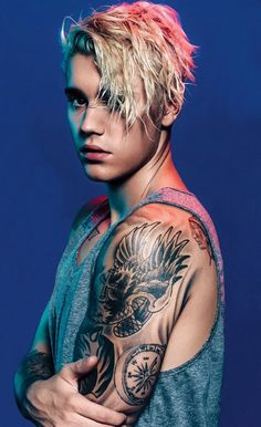 This photo of Justin bieber is from the music video what do you mean and in the billboard magazine. I love his tattoos and his hair style.