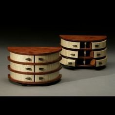Based out of Viroqua, WI, Raymond's architecturally inspired containers and vessels are created using solid hardwoods, bent and straight laminations, and veneers. He uses woods of contrasting color and value to delineate the elements of each piece. Woodworking Jewellery Box, Woodworking Guide, Woodworking Magazine, Fine Woodworking, Woodworking Projects, Small Wooden Boxes, Wooden Jewelry Boxes, Wood Boxes, Bandsaw Projects