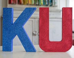 KU.  Why didn't I think of this sooner, for his room.