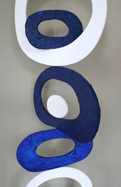 Recycled Foam Board Mobile (Blue and White) Recycled Foam Board Mobile (Blue and White) Recycled Foam Board Mobile (Blue and White)  Vertical hanging sculpture made of discarded foam board, which is a material that contains