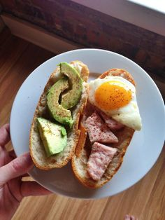 Medium rare pork chop, egg and avocado sammich for brunch, with hot sauce. Now I just need some beer.