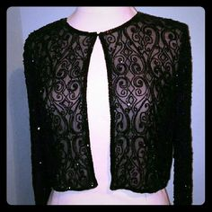 """XL Glass Bead Embroidered Cropped Jacket in Black Homemade Cropped Bolero Jacket in Black Perfect to Complete Your Formal or Semi Formal Evening Outfit Sheer Illusion With Amazing Glass Beaded Embroidery That Makes This Piece Truly Stand Out and Shine Above The Rest  Measurements: Total Length: 16"""" Chest: 40""""  All of my items are in Really Great, Excellent or Like New (or new) Condition. Non-Smoking Pet Free Home.  If you have any questions about the item please feel free to ask. Thanks for…"""