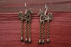 This is a copy of an authentic archeological discovery viking earrings nordic Europe area. Finougrian VIII- IX century.