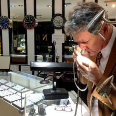 Mr Bond in his jewellery shop in Scarborough examines jewellery through his eye glass.