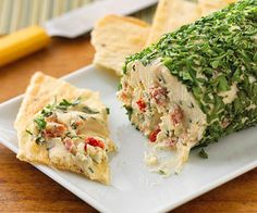 Peppered Herb Cheese Ball ~ A mixture of chives, parsley, red pepper and garlic coats a blend of cream cheese and goat cheese. Crushed walnuts add a bit of crunch.