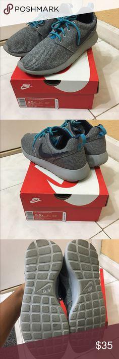 Nike rosherun gradeschool Super cute blue and grey sneakers.size 6 1/2 grade school which is a 7 1/2 in women's. Nike Shoes Sneakers