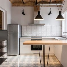 Kitchen designed for apartment from the 1930s in the Eixample in Barcelona. Original brick ceilings and hydraulic floor tiles. Project and interior design by AO arquitectura i paissatge. www.aleaolea.com #aleaolea #interiordesign #kitchendesign #lampegrasdcwedition #lampegras323 #lesacrobates #lampegras304 #kviktinta #design #furnituredesign #architecturephotography #interiorphotography #interiorismo #dissenycuines #smeg #mobles114 #tria114 #mosaichydraulic #voltesceràmiques