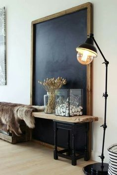 Giant blackboard propped up on wall behind rustic wood and metal fence with fur through. Décoration D´Interieur: Delightfull #DécorationDInterieur #Delightfull