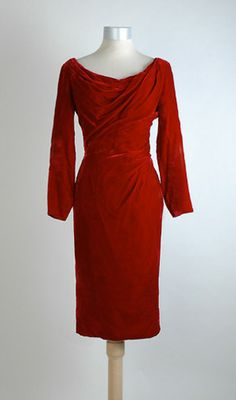 "Vintage Glamour Alert-Draped Red Velvet Cocktail Dress. ""Just came across (in 2007) this exquisite 1950′s shapley red velvet cocktail dress with Ceil Chapman type draping.  It's common to find black velvet vintage dresses, but red ones are few and far between."""