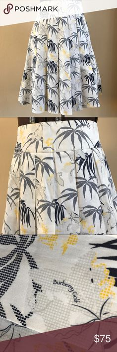 "BURBERRY GOLF PLEATED SKIRT No tags, but looks like it is in NEW condition. Burberry golf pleated skirt in white, navy and yellow. Beautiful skirt. No size tag but approx measures 15.5"" waist, 20.5"" hips, 22"" overall length and 6"" back invisible zipper. Fits like a sz 8. Burberry Skirts"
