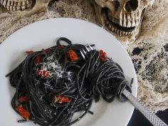 RECIPE: Halloween Black Spaghetti with Garlic, Parmesan and Sun-dried Tomatoes. Wickedly quick, creepy good Halloween pasta!  Parisienne Halloween Party, Frightening French Fête