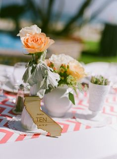 hand carved wooden state table numbers ... so cute  http://www.weddingchicks.com/2013/12/20/mint-and-peach-wedding/
