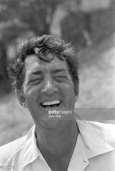 Entertainer Dean Martin plays golf in 1967.