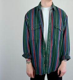 Awesome 80s flannel! Done in a forest green cotton with red, blue and white stripes. Button down front. 100% cotton, Made in the USA. Button down pockets on chest.  SIZE: Mens Large TAG SIZE: Large BRAND: Eddie Bauer Excellent Vintage Condition: Light wash and wear.  Measurements: Chest: 48 Waistband: 44 Length: 24 Sleeve: 21.5 ( underarm seam) Shoulders: 20  52016BAUER *Any overpayment exceeding $4 USD will be refunded back to your account.  *All items are measured in US inches, Shoes are…
