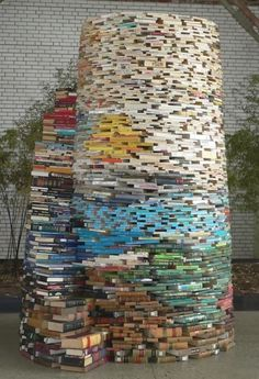 massive book sculpture of tom bendtsen; his largest structure is composed of 16,000 books
