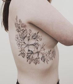 Island and NZ native floral fineline side tattoo by Tritoan Ly