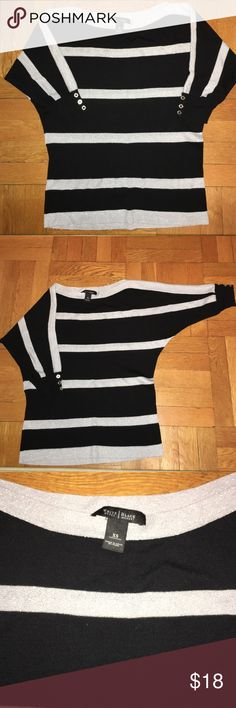 White House Black Market sweater Lightweight black and shimmery silver stripe. Machine washable. 3/4 sleeve. Has 3 silver buttons on each cuff. Dolman style yet slightly fitted near the bottom. Boat neck style. Not boxy. No holes or pulled threads. Always taken care of. White House Black Market Sweaters Crew & Scoop Necks