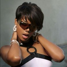 Kelis originated this tapered sides and long bangs look! This is a shot from the 'Bossy' video. #kelis #hair