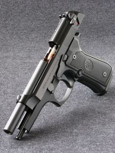 I like the Beretta 92, and this is a sweet photo. - www.Rgrips.com