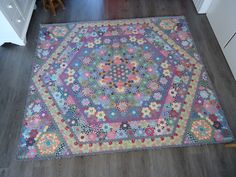 Plaid hexagons with squared off corners added.  Just wonderful!  There was an earlier picture of the hexagon center lying in the snow. WHO MADE THIS QUILT?  Could it be Ina van der Plaat?