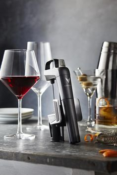 The Coravin Model Two gives wine lovers the freedom to pour any wine, in any amo. by Cave Wine Refrigerator, Wine Fridge, Cave, Wine Purse, Pinot Noir Wine, Wine Bucket, Wine Bottle Labels, Wine Bottles, Wine Corks