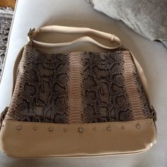 Tan and snakeskin tote bag Tan and snakeskin tote bag. Zipper closure top. Side zipper. Two side pockets. Top adjusted strap. 15 inches drop and 18 inches across. Bags Totes