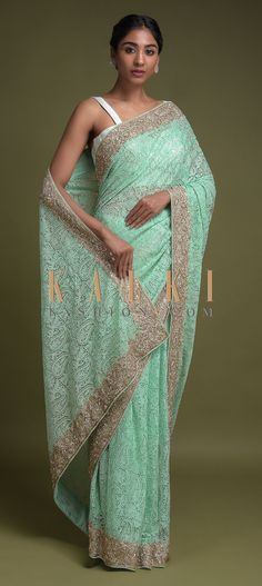 Buy Online from the link below. We ship worldwide (Free Shipping over US$100)  Click Anywhere to Tag Turq Saree In Net With Thread And Cut Dana Embroidered Paisley Pattern Online - Kalki Fashion Turq saree in net with thread, kundan and cut dana embellished paisley pattern.Border enhanced with zardozi, pita zari and sequins work.
