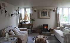 Turtledove Hideaway open plan sitting room with wood burner