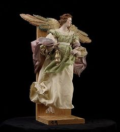 Neapolitan Baroque Angel  Giuseppe Sammartino(1720-1793)  15 3/4''h. terracotta head, wooden limbs, various fabrics.