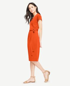 """Spring and summer call for effortless ensembles, like this one-and-done wrap dress with a beautifully draped fit. V-neck with crossover front. Short dolman sleeves. Self tie belt. Shirred waist seam. 23"""" from natural waist."""