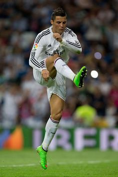 Cristiano Ronaldo of Real Madrid CF celebrates scoring their second goal from a penalty shot during the La Liga match between Real Madrid CF and Elche CF at Estadio Santiago Bernabeu on September 23, 2014 in Madrid, Spain.