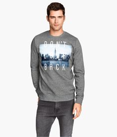 Remind yourself to go full speed ahead in this gray melange sweatshirt with printed city design.   H&M For Men