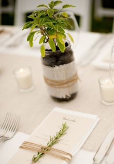 Natural with understated elegance...Live plants potted in mason jars decorated with light burlap secured with twine. and another bit of green decorating napkins on a neutral tablescape.