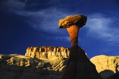 Colorful rock caps balancing on softer sandstone create The Toadstools.  These giants have been whittled away by wind and water over the eons. A moderate hike from the trailhead will get you there! Share the Experience photo by Jack Hutteball.