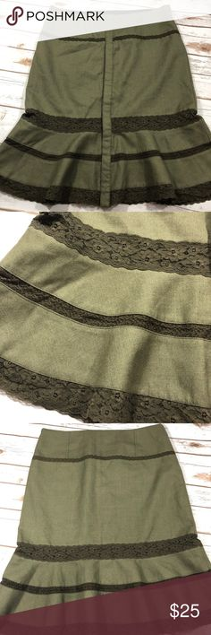 Free People Olive Wool and Lace Fit and Flare 12 Super cute the only issue is the zipper caused a couple pulls hardly noticeable see picture. 70% Wool and 30% rayon. The waist measures approximately 18in the length is approximately 25in with a snap button front! So cute any questions please ask!! Free People Skirts